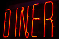 Diner neon sign. At night in street photo Stock Photography