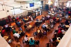 Diner op de populaire Indische Algemene Vergadering van de Koffie Royalty-vrije Stock Afbeeldingen