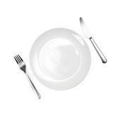 Diner plate with fork and spoon. Close up of a diner plate with fork and spoon Stock Photos