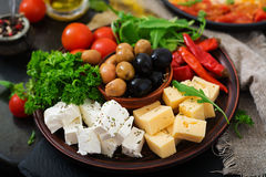 Diner platter. Olives, cheese and vegetables stock photo