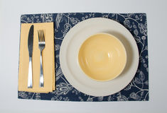 Diner Setting. Plate setting on blue and white placemat with yellow accent for diner Stock Image