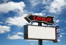 Diner Sign. Paint peeling from a 60s era old neon diner sign royalty free stock image