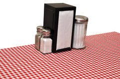 Diner Table. Table with red gingham tablecloth at diner. Isolated on white background with clipping path stock photo