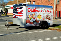 Diner Trailer. A small trailer for destiny diner in Bristol rhode island advertising breakfast lunch and ice cream with an American flag on it Royalty Free Stock Image