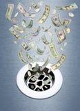 Dinero abajo del dren Fotos de archivo