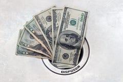 Dinero abajo del dren Foto de archivo libre de regalías