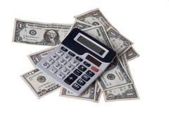 Dinero americano con la calculadora Fotografía de archivo libre de regalías