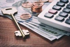 Dinero americano, moneda y llave del dólar Fotos de archivo
