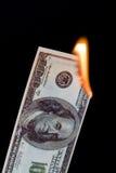 Dinero ardiente Fotos de archivo