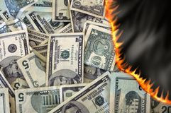 Dinero ardiente Fotografía de archivo libre de regalías