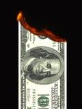 Dinero ardiente Imagen de archivo libre de regalías