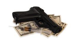 Dinero, arma y drogas fotografía de archivo