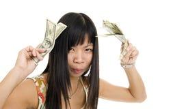 Dinero asiático joven de la mujer Imagenes de archivo
