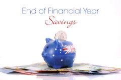 Dinero australiano con la hucha Foto de archivo libre de regalías