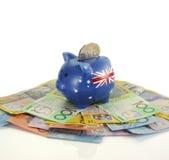 Dinero australiano con la hucha Imagen de archivo libre de regalías