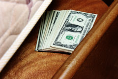 Dinero bajo el colchón Fotografía de archivo libre de regalías