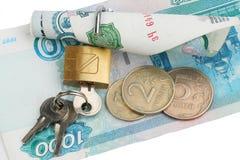 Dinero bloqueado en el bloqueo Imagenes de archivo