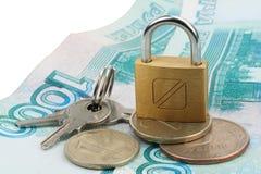 Dinero bloqueado en el bloqueo Foto de archivo