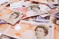 Dinero BRITÁNICO de los billetes de banco del dinero en circulación Imágenes de archivo libres de regalías
