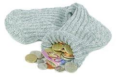 Dinero británico en un calcetín viejo Imágenes de archivo libres de regalías