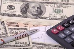 Dinero, calculadora, pluma del graphand Imagen de archivo libre de regalías