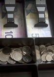 Dinero canadiense en cajón de la caja registradora Imagen de archivo libre de regalías