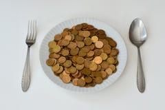 Dinero como comida cruda Fotografía de archivo libre de regalías