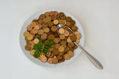 Dinero como comida cruda Imagen de archivo