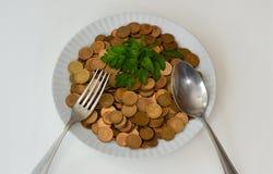 Dinero como comida cruda Imagenes de archivo