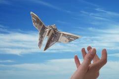 Dinero con alas Fotos de archivo libres de regalías