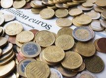 Dinero con el periódico Imagen de archivo