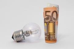 Dinero con la bombilla Imagen de archivo libre de regalías