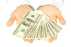 Dinero con las manos Fotografía de archivo libre de regalías