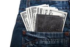 Dinero con un pasaporte en su bolsillo Fotos de archivo