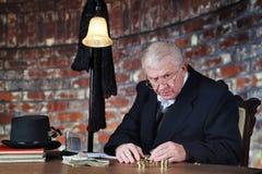 Dinero-contador gruñón imagen de archivo