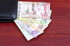 Dinero de la Arabia Saudita en la cartera negra imagen de archivo libre de regalías