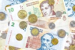 Dinero de la Argentina, de billetes de banco del Peso y de monedas Fotografía de archivo