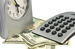 Dinero de la calculadora del reloj Imagen de archivo libre de regalías