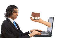 Dinero de la computadora portátil Fotografía de archivo libre de regalías