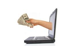 Dinero de la computadora portátil imagen de archivo libre de regalías
