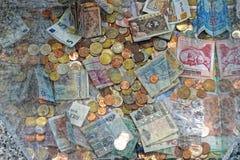 Dinero de la donación Imagenes de archivo