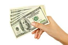 Dinero de la explotación agrícola de la mano Imágenes de archivo libres de regalías