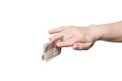 Dinero de la explotación agrícola de la mano Foto de archivo libre de regalías
