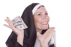 Dinero de la explotación agrícola de la monja Foto de archivo