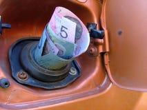 Dinero de la gasolina Imagen de archivo