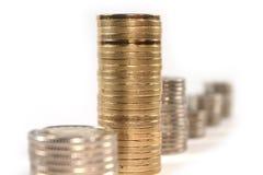 Dinero de la moneda en las pilas aisladas Imagen de archivo libre de regalías