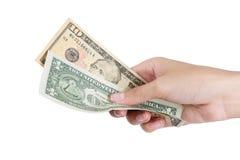 Dinero de la paga Fotos de archivo