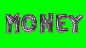 Dinero de la palabra de las letras de plata del globo del helio que flotan en la pantalla verde - almacen de metraje de vídeo