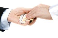 Dinero de la toma Fotos de archivo libres de regalías