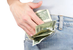 Dinero de los ahorros en bolsillo en blanco Foto de archivo